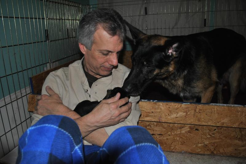 John teaching Nina to allow her puppies to be slightly away from mom